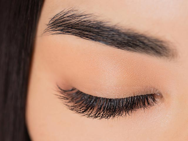Woman after lash & brow treatment